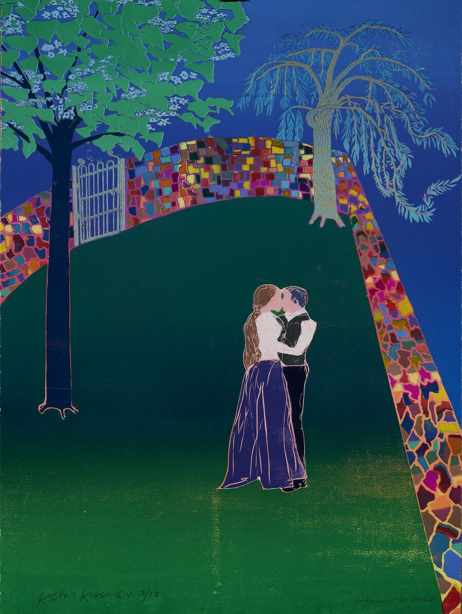 Couple in an embrace in a garden.